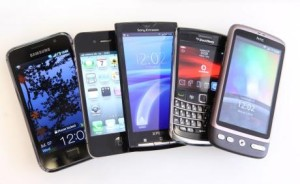 Leading Brands Of Smart Phones...A collection of smartphones, from left, a Samsung Galaxy S, an Apple Inc. iPhone 4, a Sony Ericsson Xperia X10, a Blackberry 9700, and an HTC Desire, are arranged for a photograph in London, U.K., on Wednesday, July 7, 2010. Global smartphone sales will rise 36 percent to 247 million in 2010, ISuppli Corp. said in April. Photographer: Chris Ratcliffe/Bloomberg